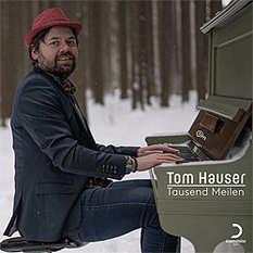 Tom Hauser, Tausend Meilen